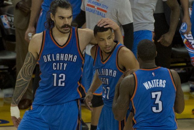 Oklahoma City Thunder center Steven Adams (12) celebrates with guard Andre Roberson (21) on May 16, 2016 at Oracle Arena in Oakland, California. File photo by Terry Schmitt/UPI