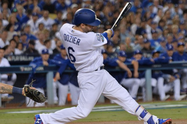 Former Los Angeles Dodgers infielder Brian Dozier hits an RBI single scoring Chris Taylor during the sixth inning in Game 4 of the National League Championship Series against the Milwaukee Brewers on October 18 at Dodger Stadium in Los Angeles. Photo by Jim Ruymen/UPI