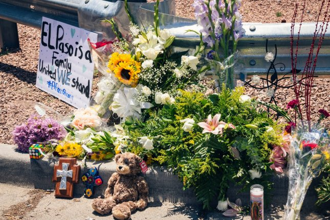 A memorial lies outside of Walmart where Saturday's mass shooting took place in El Paso, Texas.  Photo by Justin Hamel/UPI