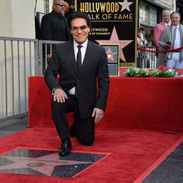 Iranian-Armenian American singer, songwriter and actor Andy Madadian kneels next to his star during an unveiling ceremony honoring him with the 2,684th star on the Hollywood Walk of Fame on Friday. Photo by Jim Ruymen/UPI