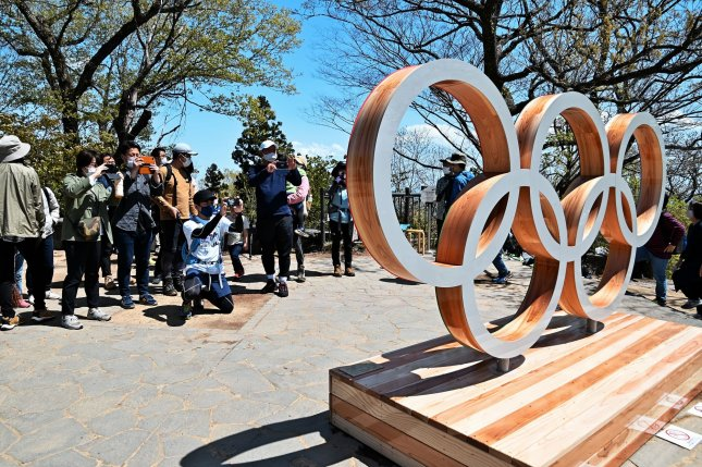 Spectators take photos of the Olympic rings at the top of Mt. Takao in Hachioji, Tokyo, Japan on April 18, 2021. The Olympic baseball tournament is set to run from July 28 to Aug. 7. File Photo by Keizo Mori/UPI
