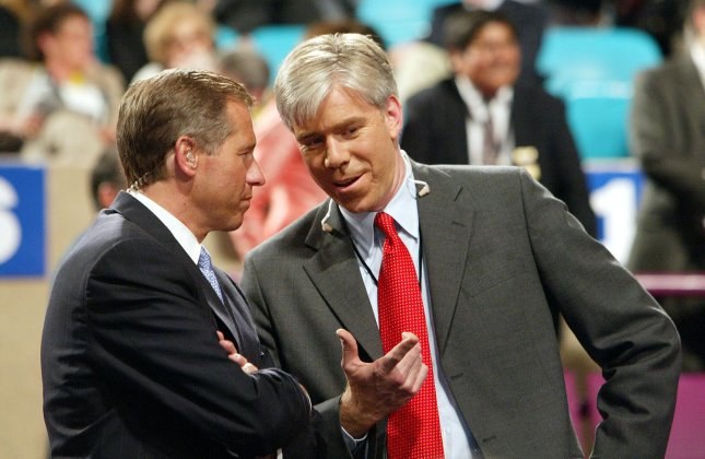 NBC News' Brian Williams (L) and David Gregory share a story from the floor of the Republican National Convention at Madison Square Garden in New York on September 1, 2004. (UPI Photo/Bill Greenblatt)