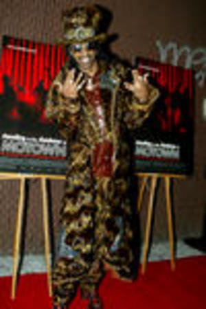 NYP2002110856 - NEW YORK, Nov. 8 (UPI) -- Bootsy Collins poses for pictures at the Premiere of Standing in the Shadows of Motown at the Apollo Theater in Harlem, New York on November 7, 2002. lc/Laura Cavanaugh UPI