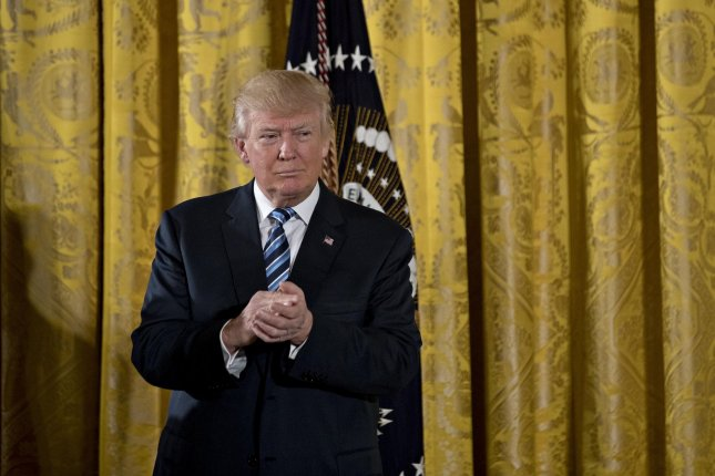 U.S. President Donald Trump, pictured during a swearing in ceremony the White House on Sunday, said before some of his senior staff took their oaths that he has scheduled meetings with the president of Mexico and prime minister of Canada to start renegotiating the North American Free Trade Agreement. Pool photo by Andrew Harrer/UPI