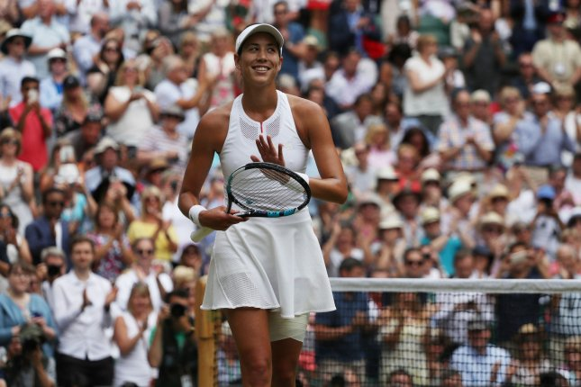 Muguruza wins 1st set 7-5 in Wimbledon final