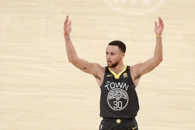 Golden State Warriors guard Stephen Curry reacts after hitting a 3-point shot and getting fouled in the third quarter against the New York Knicks on February 26 at Madison Square Garden in New York City. Photo by John Angelillo/UPI