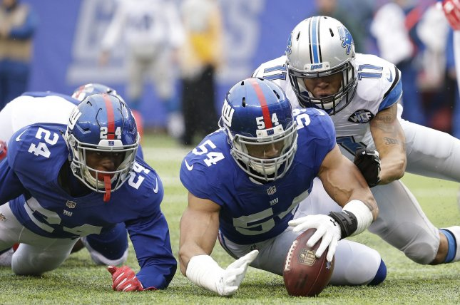 New York Giants cornerback Eli Apple (24) watches defensive end Olivier Vernon (54) recover a fumble in the end zone for a touchback in the first half in Week 15 of the NFL season on December 18, 2016 at MetLife Stadium in East Rutherford, New Jersey. File photo by John Angelillo/UPI
