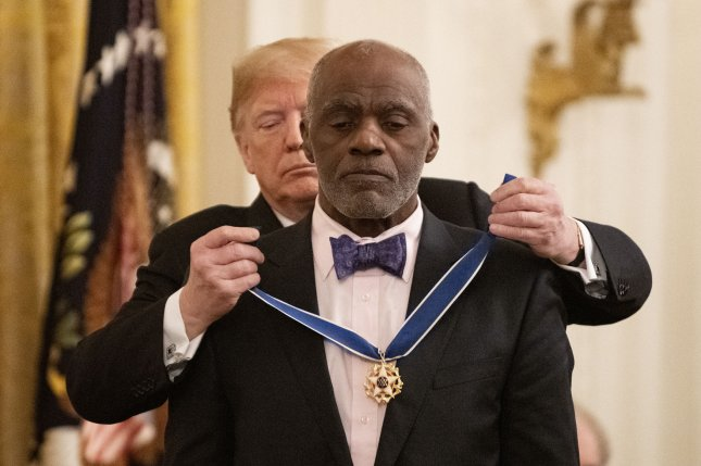 President Donald Trump awards the Medal of Freedom to Alan Page, football great and Minnesota Supreme Court justice, during a ceremony in the East room of the White House in Washington, D.C. on Friday. Photo by Pat Benic/UPI
