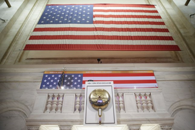 American Flags hang last Friday at the empty platform where closing bell ceremonies usually take place at the New York Stock Exchange, on Wall Street in New York City. Photo by John Angelillo/UPI