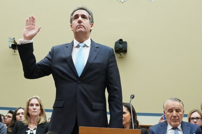 Michael D. Cohen raises his right hand as he is sworn in before testifying in front of the House oversight committee on February 27, 2019, in Washington, D.C. Cohen, once one of President Donald Trump's most trusted aides and attorneys, releases a book Tuesday highly critical of Trump's presidency. File Photo by Kevin Dietsch/UPI