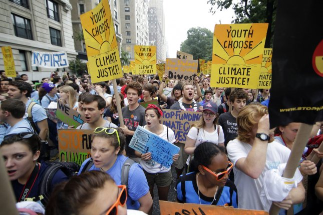 Participants march down Central Park West at the People's Climate March in New York City on September 21, 2014. File Photo by John Angelillo/UPI