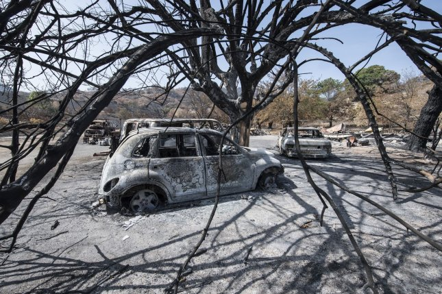 President Donald Trump changed his mind Friday and approved an emergency aid request from the state of California for damaging September wildfires that have burned almost 2 million acres. File Photo by Terry Schmitt/UPI