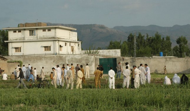 A view of Osama bin Laden's compound in Abbottabad, Pakistan, shows local and international media along with local residents gathered in front of the compound on Thursday, May 5, 2011, after a U.S. military raid late which ended with the death of the al-Qaida leader bin Laden and others inside. UPI/Sajjad Ali Qureshi