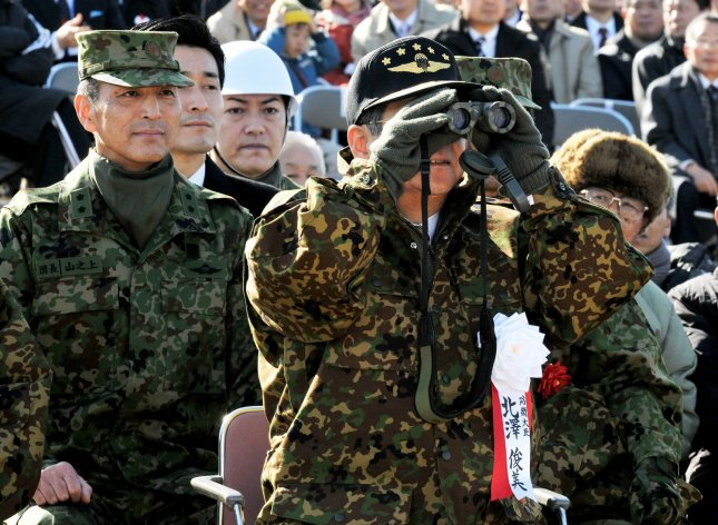 Japan's Defense Minister Toshimi Kitazawa inspects the new year drill of the 1st Airborne Brigade at the Narashino Training Field in Chiba prefecture, Japan, on January 9, 2011. UPI/Keizo Mori