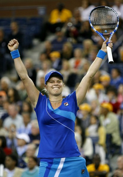 Kim Clijsters, shown after winning the 2010 U.S. Open, took a three-set win Wednesday and will move to the No. 1 world ranking if she wins a quarterfinal match Friday. UPI /Monika Graff