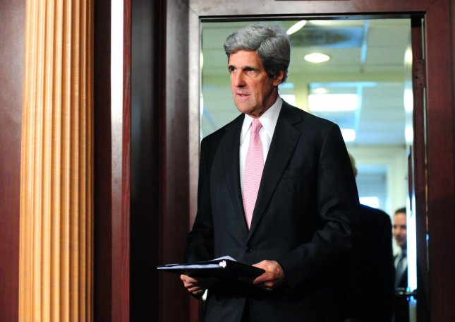 Sen. John Kerry (D-MA) arrives at a press conference where he announced a bill to give State Department funding to help Tunisia and Egypt following their recent revolutions, in Washington on March 10, 2011. UPI/Kevin Dietsch