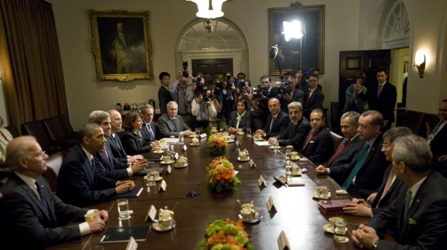 President Barack Obama and the American delegation (L) meet with Turkish Prime Minister Recep Tayyip Erdogan and the Turkish delagation (R) in the Cabinet Room of the White House in Washington, DC on May 16, 2013. The situation in Syria was at the top of the agenda. UPI/Pat Benic