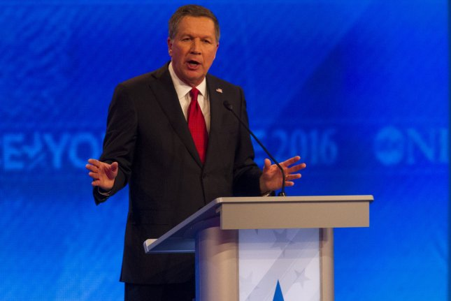 Republican candidate for President John Kasich responds to a question during a Republican presidential debate at Saint Anselm College in Manchester, New Hampshire, Saturday, February 6, 2016. Photo by Matthew Healey/UPI