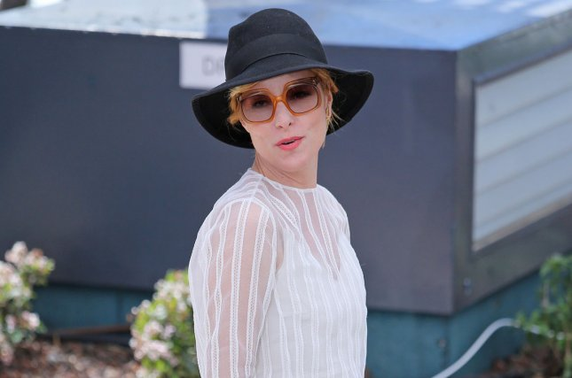 Parker Posey arrives at a photo call for the film Irrational Man during the 68th annual Cannes International Film Festival on May 15, 2015. Posey has been cast in a reboot of classic television series, Lost in Space. File Photo by David Silpa/UPI