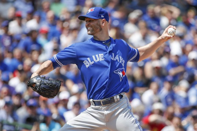 Toronto Blue Jays starting pitcher J.A. Happ delivers against the Chicago Cubs in the first inning on August 18, 2017 at Wrigley Field in Chicago. Photo by Kamil Krzaczynski/UPI