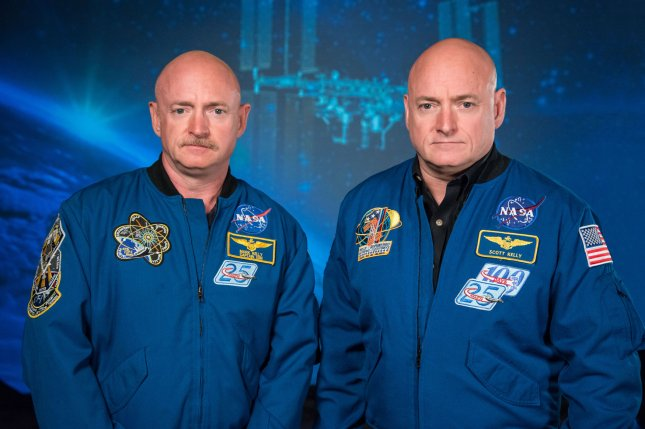 Researchers are tracking the health and biology of twin brothers and astronauts Scott Kelly (R) and Mark Kelly. File Photo by Robert Markowitz/NASA