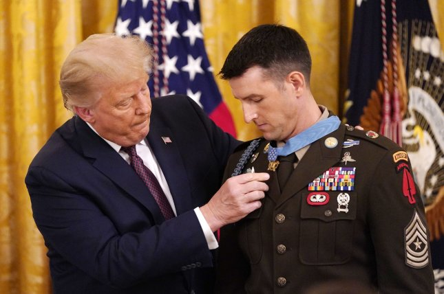 President Donald Trump presents the Medal of Honor to U.S. Army Sgt. Maj. Thomas Payne in the East Room of the White House in Washington, D.C., on Friday. Photo by Chris Kleponis/UPI