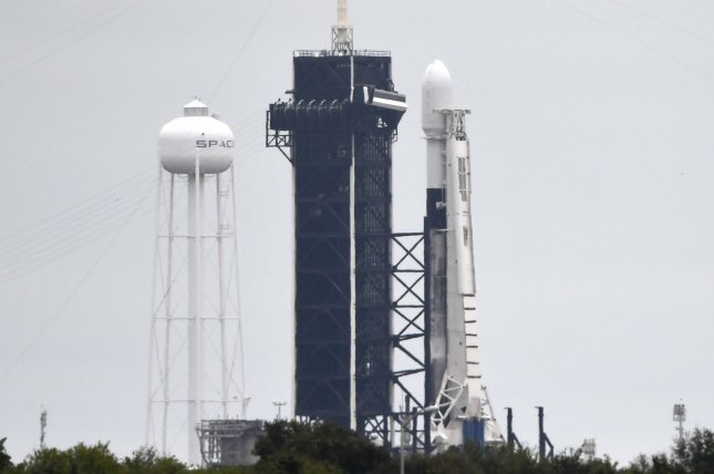 A SpaceX Falcon 9 rocket like this shown in December might be launched as early as Monday following an aborted countdown Sunday night. File Photo by Joe Marino/UPI