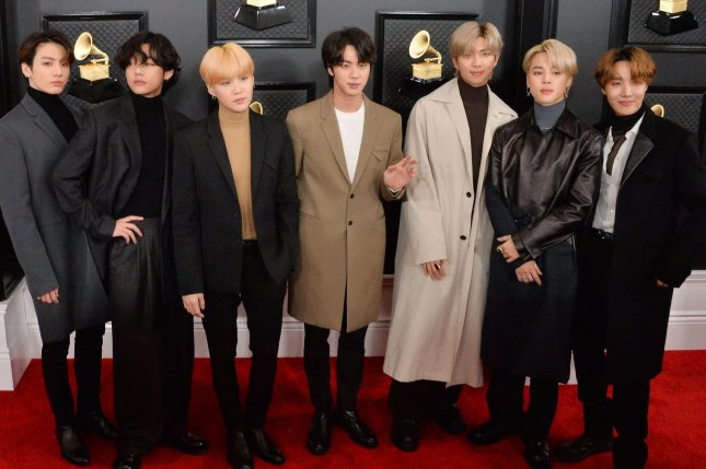 Left to right, RM, V, Suga, Jin, Jimin, Jungkook and J-Hope, of music group BTS, arrive for the 62nd annual Grammy Awards in January 2020. The band will be releasing a new English-language song titled Butter. File Photo by Jim Ruymen/UPI
