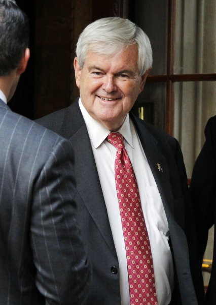 United States of America Republican presidential candidate and former House Speaker Newt Gingrich walks outside after speaking at the Union League Club In New York City on December 5, 2011. Earlier in the day Gingrich met with Donald Trump at Trump Tower. UPI/John Angelillo