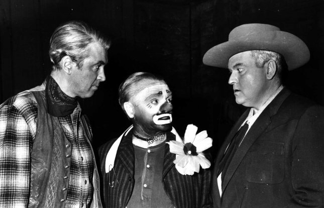 LAPX97070212 - 2 JULY 1997 - HOLLYWOOD, CALIFORNIA, USA: Actor Jimmy Stewart in a 1956 file photo, with actors Jim Cagney (center0 and Orson Welles in Hollywood. Stewart died today in his Beverly Hills, California home. Stewart was 89. cs/files UPI