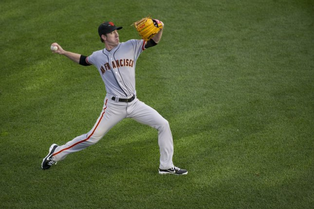 San Francisco Giants pitcher Tim Lincecum warms up in the outfield before pitching against the Washington Nationals at Nationals Park on August 14, 2013 in Washington, D.C. UPI/Kevin Dietsch