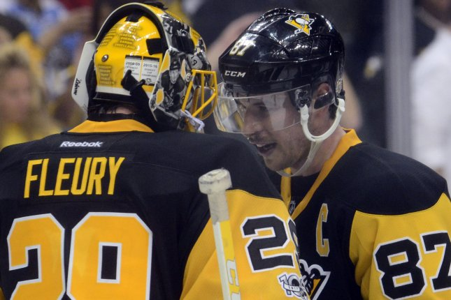 Pittsburgh Penguins center Sidney Crosby (87) joins Pittsburgh Penguins goalie Marc-Andre Fleury (29) to celebrate the 5-2 win of game five and the four game to one victory in the series against the Columbus Blue Jackets in the opening round of NHL Eastern Conference Playoff series at PPG Paints Arena in Pittsburgh on April 20, 2017. Photo by Archie Carpenter/UPI