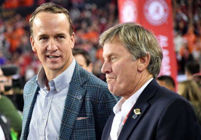 NFL great Peyton Manning and college football icon Steve Spurrier watch from the sidelines during the first quarter of the 2017 College Football Playoff National Championship, in Tampa, Florida, on January 9. Photo by Kevin Dietsch/UPI