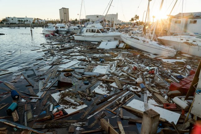 Damage to the dock as well as sail and power boats heaped together show the power of Hurricane Michael in Panama City Marina in Florida on Friday. Photo by Ken Cedeno/UPI