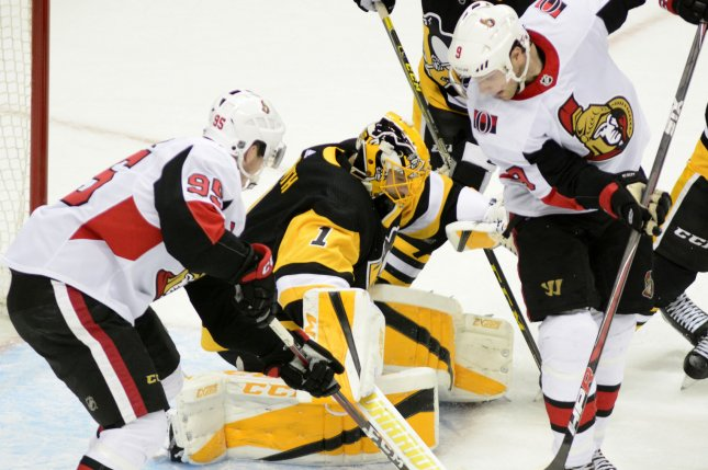 Pittsburgh Penguins goaltender Casey DeSmith (1) denies the scoring attempts of Ottawa Senators center Matt Duchene (95) and right wing Bobby Ryan (9) in the final seconds of the Penguins' 4-0 win on April, 6 in Pittsburgh. Photo by Archie Carpenter/UPI