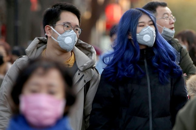 People wear protective respiratory masks in Beijing on Saturday. Photo by Stephen Shaver/UPI