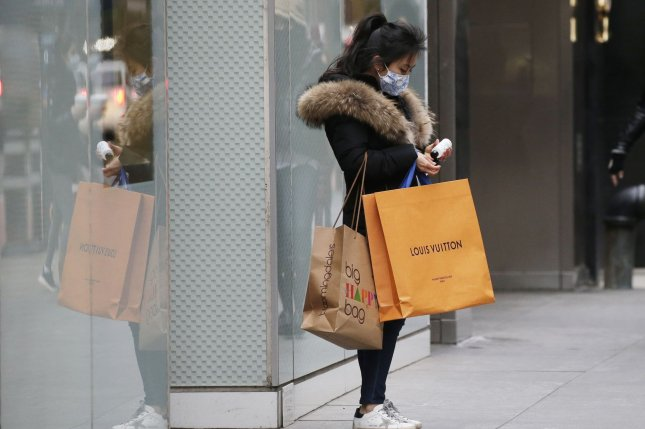 A shopper exits a store on Fifth Avenue in New York City on January 5. Photo by John Angelillo/UPI