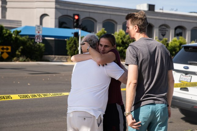 People embrace behind the police line across the street from Chabad of Poway Synagogue in Poway, Calif., on April 27, 2019. File Photo by Ariana Drehsler/UPI