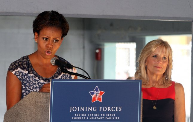 First Lady Michelle Obama (L) and Dr. Jill Biden speak to military families as part of the Joining Forces Initiative at the NASCAR Sprint Cup Ford 400 at Homestead-Miami Speedway in Homestead, Florida on November 20, 2011. UPI/Michael Bush