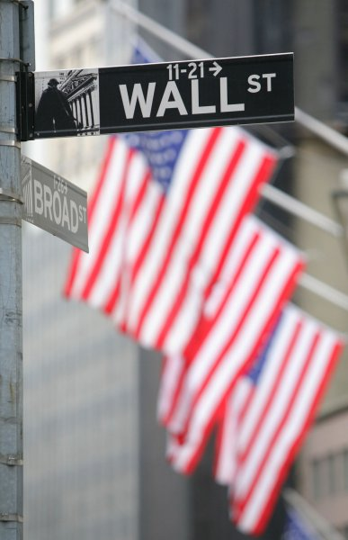 Flags hanging on the facade of the New York Stock Exchange are seen behind the street sign as the Dow fell a record 770 points after Congress voted against passing the $700 billion financial market bailout bill on September 29, 2008 in New York City. (UPI Photo/Monika Graff)