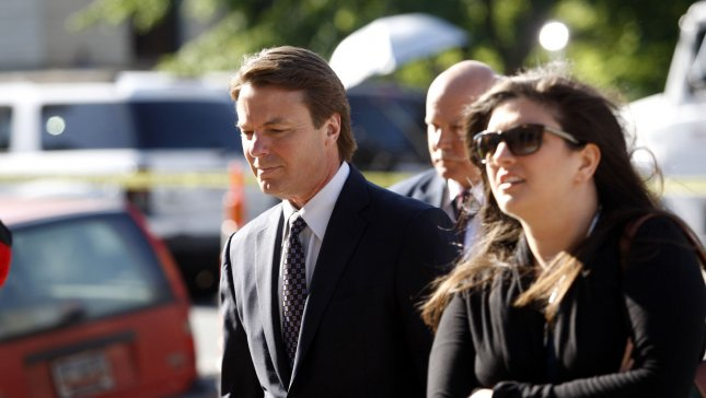 Former U.S. Senator and presidential candidate John Edwards, left, arrives with his daughter Cate at the federal courthouse in Greensboro, North Carolina on April 24, 2012. UPI/Nell Redmond
