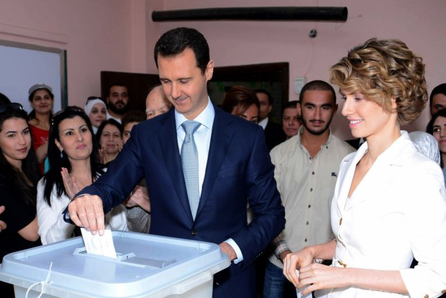 In this photo released by Syria's national news agency, Syrian President Bashar al-Assad and Syrian first lady Asma Assad vote in the country's presidential election at a polling station in Maliki, a residential area in the center of the capital Damascus, Syria, on June 3, 2014. (UPI)