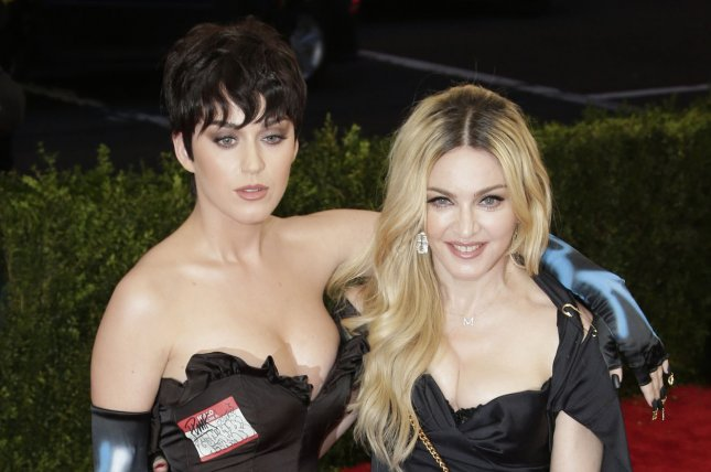 Katy Perry (L) and Madonna at the 2015 Met Gala in May. The singer will appear in Madonna's upcoming 'Bitch I'm Madonna' music video. File photo by John Angelillo/UPI