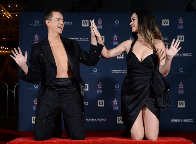 Designer Jeremy Scott and singer Katy Perry participate in a handprint ceremony at TCL Chinese Theatre in Los Angeles on Sept. 8, 2015. Photo by Jim Ruymen/UPI
