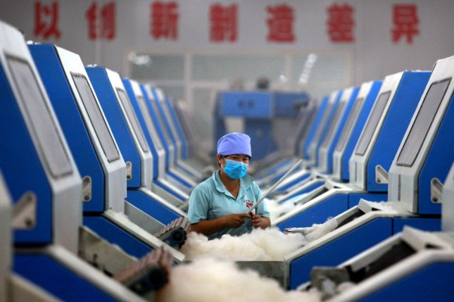 Textile production, mostly done in Asia, involves the use of many chemicals. Researchers in Sweden are looking at what sorts of toxins may be leftover by the time someone final puts on a shirt or dress. File photo by UPI/Stephen Shaver