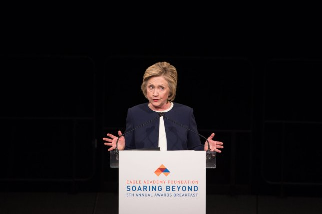 Former U.S. Secretary of State and current Democratic presidential candidate Hillary Clinton, seen above giving a keynote speech in April, may need to be deposed as part of a lawsuit regarding use of her private email server while State Department chief, according to a federal judge. Photo by Bryan R. Smith/UPI