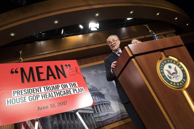 Senate Minority Leader Charles Schumer of New York conducts a press conference to speak out against the Republican healthcare bill, in Washington, D.C., on June 30. Next to him is a poster about the House plan to replace President Obama's Affordable Care Act. Photo by Kevin Dietsch/UPI