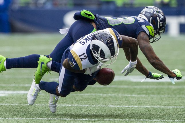 Seattle Seahawks defensive back Tedric Thompson (33) jars the ball loose from Los Angeles Rams wide receiver Brandin Cooks (12) during the second quarter on October 7, 2018 at CenturyLink Field in Seattle, Washington. Photo by Jim Bryant/UPI