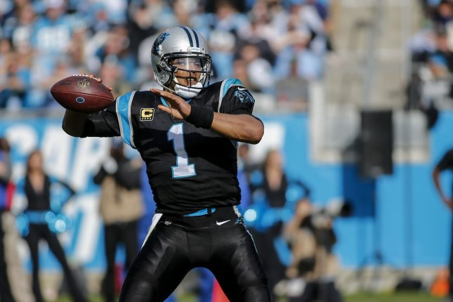 Carolina Panthers quarterback Cam Newton (1) passes against the Seattle Seahawks in the first half of an NFL football game on November 25 in Charlotte, N.C. Photo by Nell Redmond/UPI