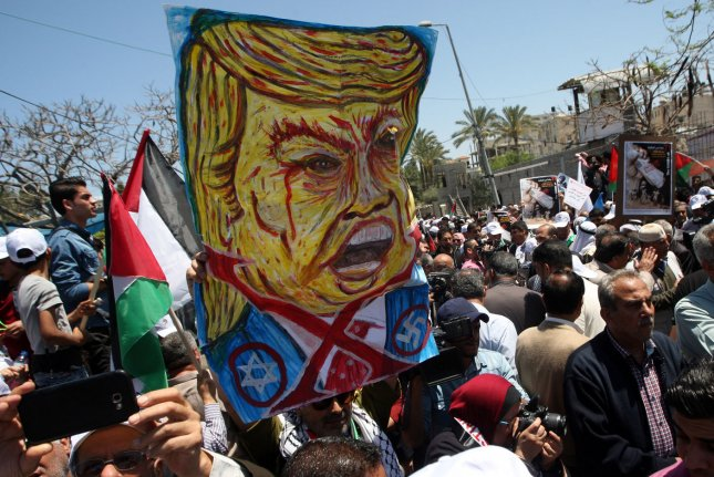 Palestinian protesters rally against U.S. President Donald Trump on the 71st anniversary of the Nakba in Gaza City on May 14. Nakba means catastrophe in Arabic, a reference to the birth of Israel in 1948. Photo by Ismael Mohamad/ UPI